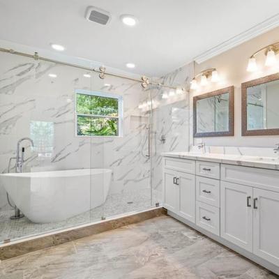 Countertop: Quartz (Calacatta) 4'' backsplash Laminated straight edge Wall cover: Porcelain Tile (Calacatta)